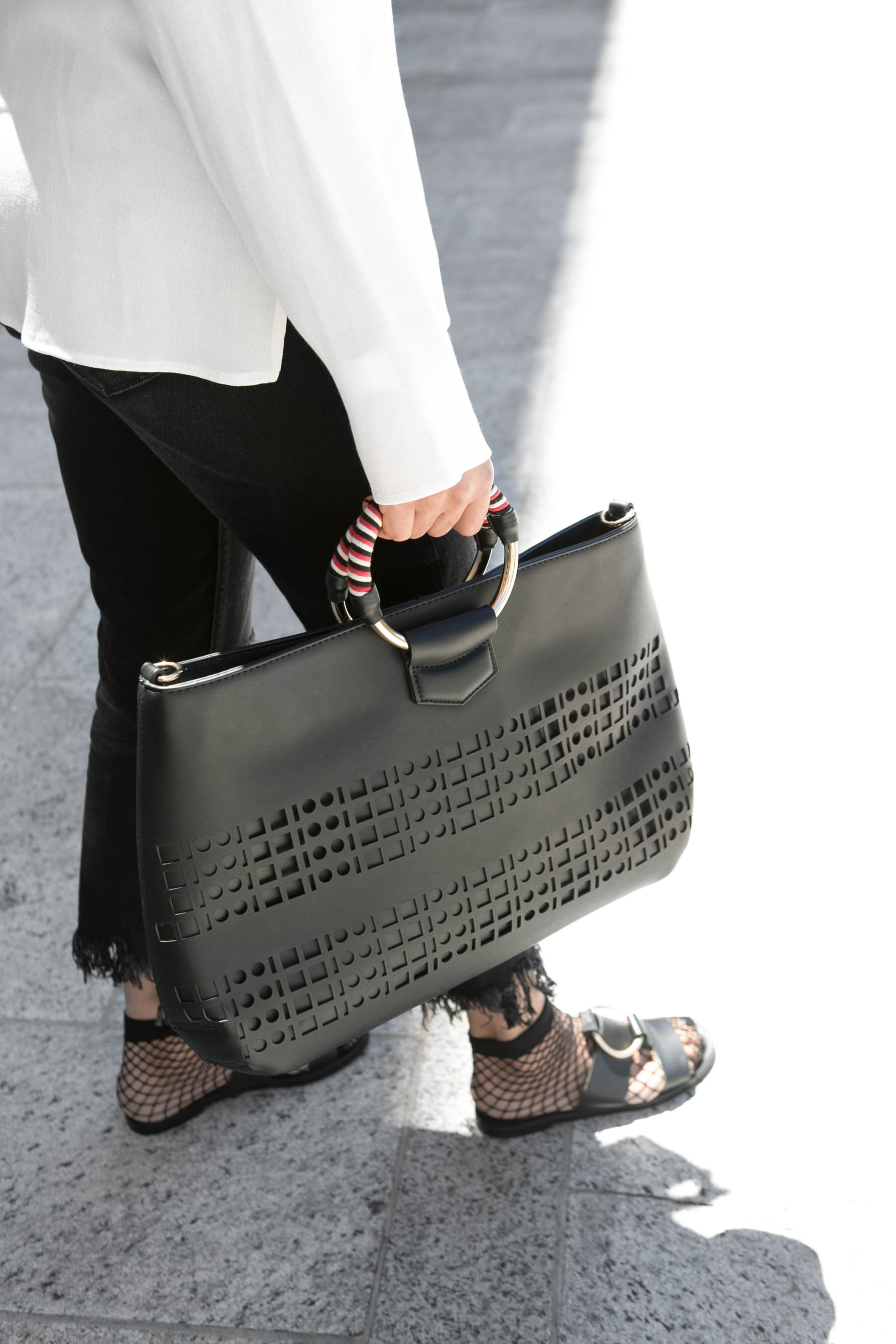 Mango bag and sandals with fishnet socks